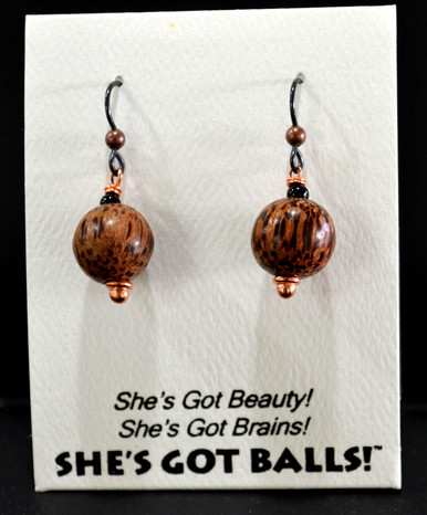 """Each pair of our wooden balls consists of genuine carved palm wood on French wires, accompanied by our delightfully tacky packaging. Our balls come mounted on this card, with the inscription """"She's Got Beauty! She's Got Brains! She's Got Balls!"""""""