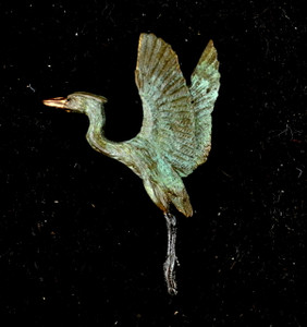 """Cavin Richie design heron rising pin, cast in lightweight artist's bronze, 175"""" X 1.3 """". Casting was created from one of Cavin's original shed-elk antler or  woolly mammoth ivory carvings, to give the finished product more natural detail than is possible with a wax carving. Cast in the USA and hand finished in Washington State."""