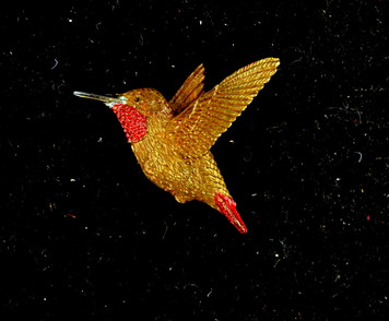 """Cavin Richie design hummingbird rising  pin, cast in lightweight artist's bronze, 1.1"""" X 1.25 """". Casting was created from one of Cavin's original shed-elk antler or  woolly mammoth ivory carvings, to give the finished product more natural detail than is possible with a wax carving. Cast in the USA and hand finished in Washington State."""