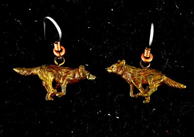 """Cavin Richie running wolf earrings on French wires, cast in lightweight artist's bronze, 0.04"""" X 1.0"""".  The earring hooks are made from gray niobium (hypoallergenic) with heishi beads and coils.  Casting was created from one of Cavin's original shed-elk antler or  woolly mammoth ivory carvings, to give the finished product more natural detail than is possible with a wax carving. Cast in the USA and hand finished in Washington State."""