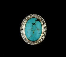 """Sterling silver ring with oval turquoise stone 0.7"""" X 0.5"""", surrounded by a wheat design."""