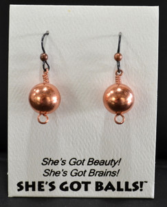 "Each pair of brass balls comes on French wires, accompanied by our delightfully tacky packaging. Our balls are mounted on this card, with the inscription ""She's Got Beauty! She's Got Brains! She's Got Balls!"""