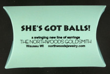 "Our balls are delivered in this box, with the inscription ""a swinging new line of earrings."""