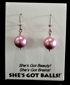 "Each pair of pink balls consists of high quality created Swarovski pearls on French wires, accompanied by our delightfully tacky packaging. Our balls come mounted on this card, with the inscription ""She's Got Beauty! She's Got Brains! She's Got Balls!"""