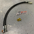 Drift American Extended Length Steel Braided Brake Lines for Ford Mustang shown in black.