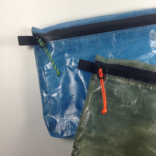 Aquatica on blue pouch, Neon Orange on olive green pouch