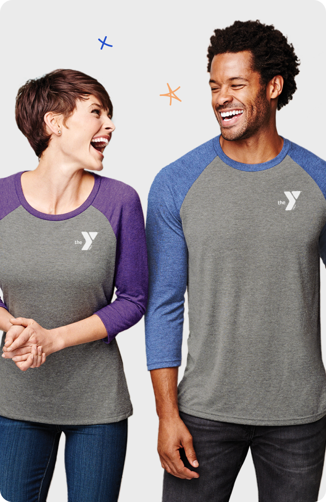 Couple laughing together wearing YMCA shirts