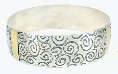 Sterling silver and 18tk gold bangle bracelet.