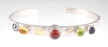 A PROTECT THIS WOMAN BRACELET, GARNET