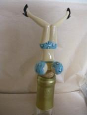 Wine Bottle Topper. Blue with spring action bosom.