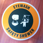 Custom eyewash safety shower sign with graphics.