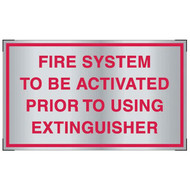 Photograph of the Aluminum fire system activation sign for cooking system fire control systems.