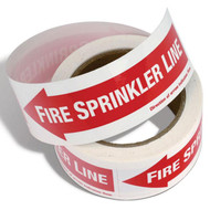 Photograph of the Fire Sprinkler Line Self-Adhesive Labels w/ Directional Arrows partially unraveled.