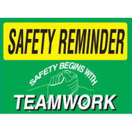 Drawing of green and yellow safety reminder safety begins with teamworks sign.