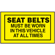 Drawing of yellow and black seat belts must be worn in this vehicle at all times.