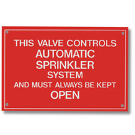 Red sign with white lettering reads THIS VALVE CONTROLS AUTOMATIC SPRINKLER SYSTEM AND MUST ALWAYS BE KEPT OPEN.