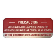 """Picture of the Aluminum caution sign for cooking system fire control systems in Spanish, 5""""w x 2""""h."""