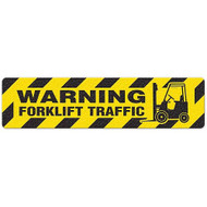 """Photograph of an anti-slip floor safety sign reading """"Warning Forklift  Traffic"""" in black on a yellow background.  Includes a graphic of a black forklift."""