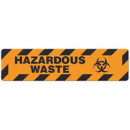 """Photograph of an anti-slip floor safety sign reading """"Hazardous Waste"""" in black on an orange background.  Includes a graphic of a black biohazard symbol."""