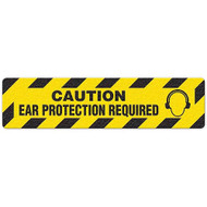 """Photograph of an anti-slip floor safety sign reading """"Caution Ear Protection Required"""" in black on a yellow background.  Includes a graphic of a head wearing ear muffs."""