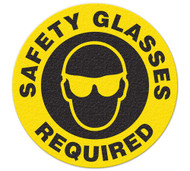 A photograph of a 05231 anti-slip safety floor markers, reading safety glasses required with graphic.