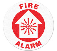A red and white photograph of a 05235 anti-slip safety floor markers, reading fire alarm with graphic.