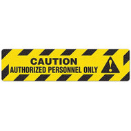 """Photograph of an anti-slip floor safety sign reading """"Caution Authorized Personnel Only"""" in black on a yellow background.  Includes a graphic of a yellow exclamation point  in a black triangle."""