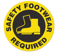 A yellow and black photograph of a 05213 anti-slip safety floor markers, reading safety footwear required with graphic.