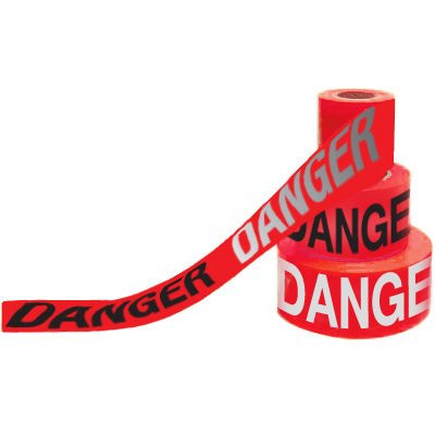 A red and black photograph of a 05351 day/night barricade tape, reading danger.