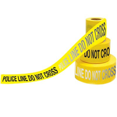 A yellow and black photograph of a 05353 day/night barricade tape, reading police line do not cross.