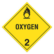 A yellow and black photograph of a 03104 class 2 dot hazardous material placards, reading oxygen with graphic.