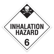 A white and black photograph of a 03118 class 6 dot hazardous material placards, reading inhalation hazard 6 with graphic.