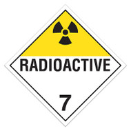 A yellow and white photograph of a 03119 class 7 dot hazardous material placards, reading radioactive 7 with graphic.