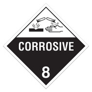 A white and black photograph of a 03120 class 8 dot hazardous material placards, reading corrosive 8 with graphic.