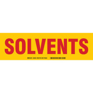A red and yellow photograph of a 03406 solvents cabinet label.