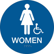 A blue and white photograph of a 03479 California ada rest room sign, reading women, with grade 2 braille and wheelchair graphic.