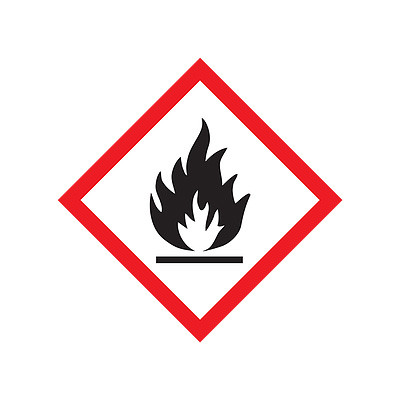 A red and white photograph of a 03600 GHS flame pictogram label.