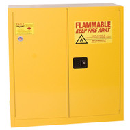 A photograph of a yellow standard 02006 eagle flammable liquid safety cabinets, with 30 gallon capacity and both doors closed.