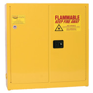 A photograph of a yellow 02008 eagle wall-mount flammable liquid safety cabinets, with 24 gallon capacity and both doors closed.
