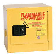 A photograph of a yellow 02014 bench top flammable liquid safety cabinets, with 2 gallon capacity and door closed.