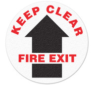 A photograph of white and black 05239 anti-slip safety floor markers, reading keep clear fire exit with arrow graphic.