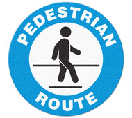 A photograph of blue and white 05256 anti-slip safety floor markers, reading pedestrian route with graphic.