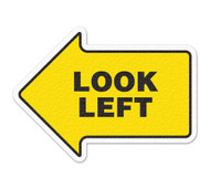 A photograph of yellow and black 05259 anti-slip safety floor markers, reading look left with arrow shape.