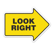 A photograph of yellow and black 05260 anti-slip safety floor markers, reading look right with arrow shape.