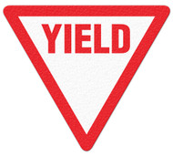 A photograph of red and white 05263 anti-slip safety floor markers, reading yield, with triangle shape.