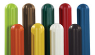A photograph of a variety of colored 02250 eagle fluted bollard post sleeves.