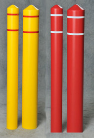 A photograph of four 02285 eagle smooth bollard post sleeves with reflective striping in both red and yellow, and differing diameters.