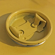 A photograph of a 02365 vent plug for eagle metal cabinets.