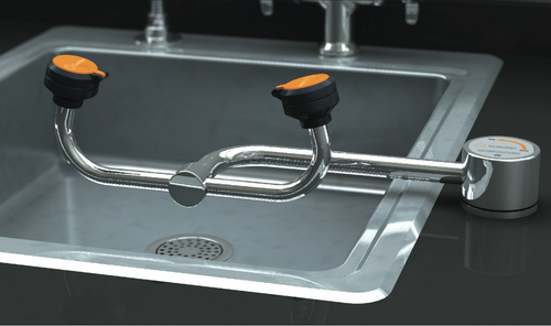 A photograph of a Guardian G1805 Eyewash, Deck Mounted, AutoFlow™ 90º Swivel mounted to the right of a sink (sink is not included).