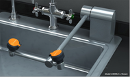 A photo of a Guardian G1899 Eyewash, Deck Mounted, AutoFlow™ Swing-Down, All-Stainless Steel mounted on the rear right side of sink (sink not included)